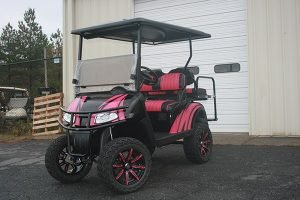Love Bug Pink and Black Custom Lifted EZ-GO RXV Golf Cart